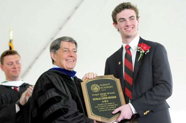 Nicholas Krikor Boyagian, right, receives the Varsity Club award for his athletic contributions from Head of School Douglas North, center, during commencement exercises on Tuesday, June 9, 2015, at The Albany Academy in Albany, N.Y. (Cindy Schultz / Times Union) Photo: Cindy Schultz / 00032210A