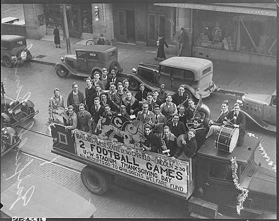 Garfield High School students promote a Thanksgiving high school football doubleheader in 1935. Photo: Seattle Post-Intelligencer Archive,  As Preserved By The Museum Of History & Industry