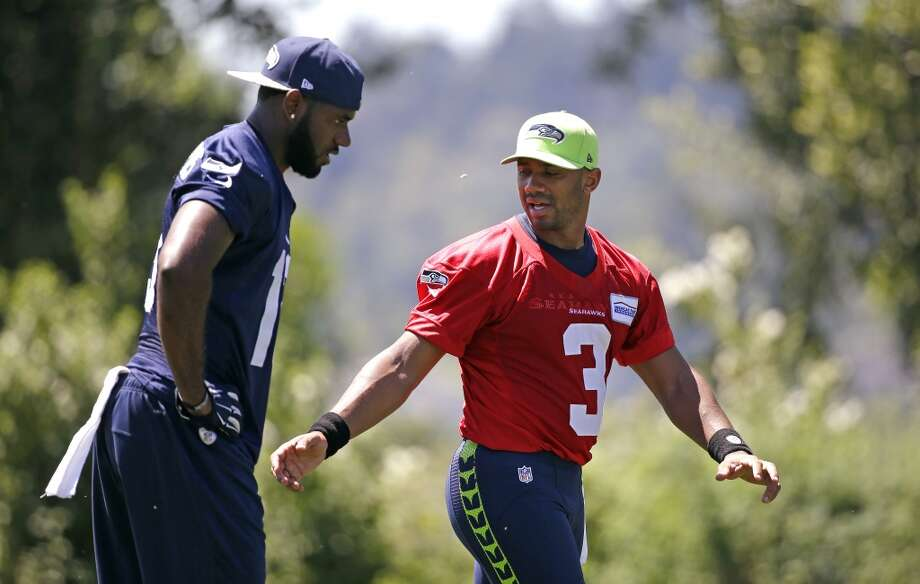 Seattle Seahawks quarterback Russell Wilson (3) walks with Chris Matthews following an NFL football organized team activity Tuesday, June 9, 2015, in Renton, Wash. (AP Photo/Elaine Thompson) Photo: AP
