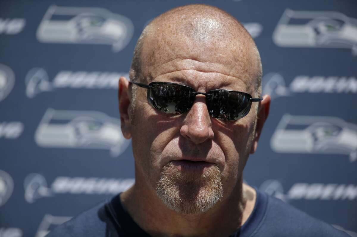Seattle Seahawks' assistant coach Tom Cable speaks to media members following an NFL football organized team activity Tuesday, June 9, 2015, in Renton, Wash. (AP Photo/Elaine Thompson)
