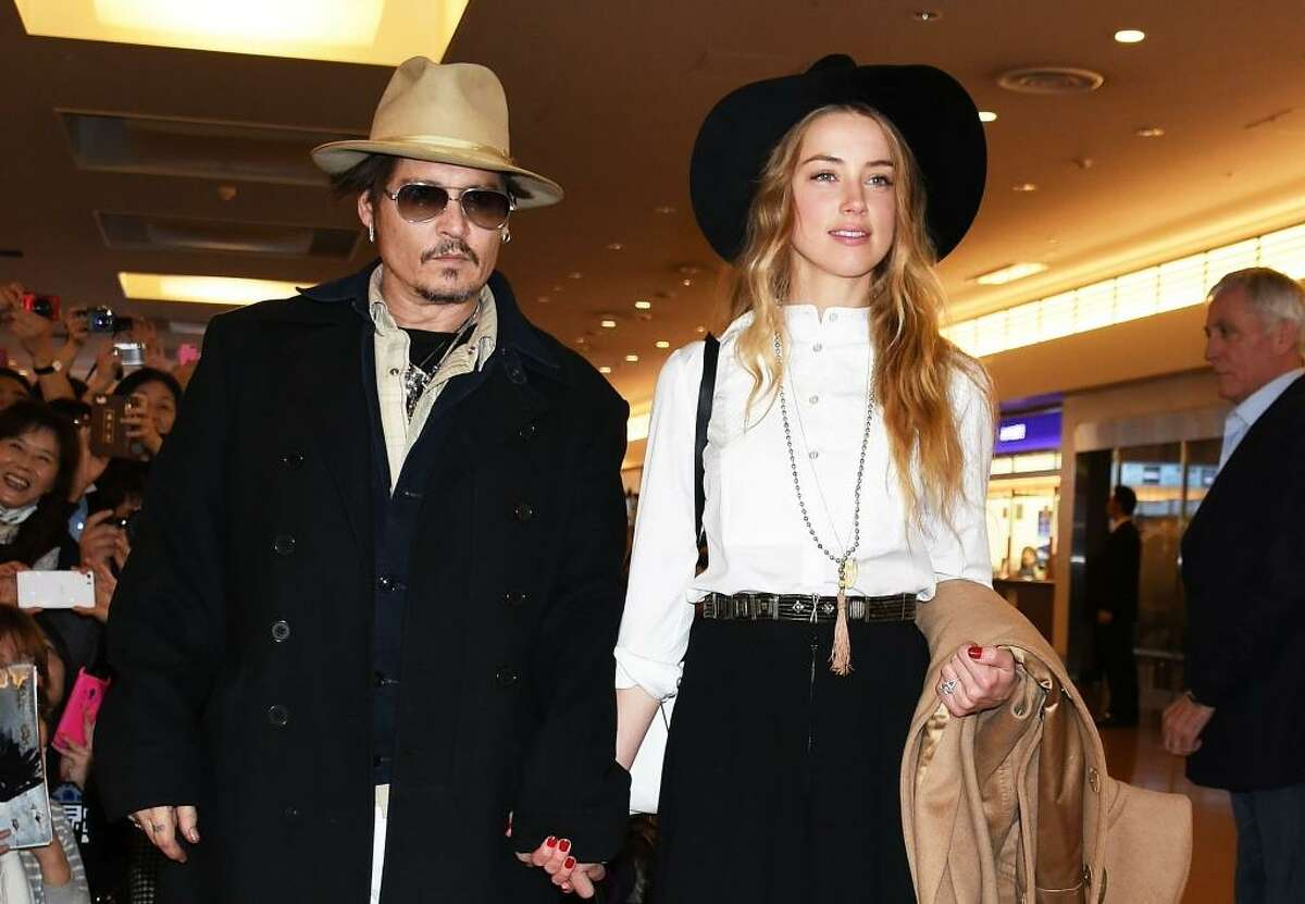 Johnny Depp and Amber Heard are seen upon arrival at Haneda Airport on January 26, 2015 in Tokyo, Japan.