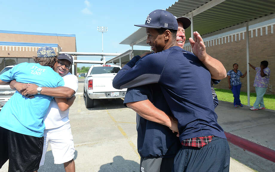 Senior Jermaine Mitchell, who will be taking in the state finals action from the dugout after injuring his knee in the play-offs, gets hugs as he and teammates get ready to board the bus for Austin. Family, friends and other members of the community turned out Tuesday morning at West Orange Stark High School for a spirited send-off. Photo taken Tuesday, June 9, 2015 Kim Brent/The Enterprise Photo: Kim Brent / Beaumont Enterprise
