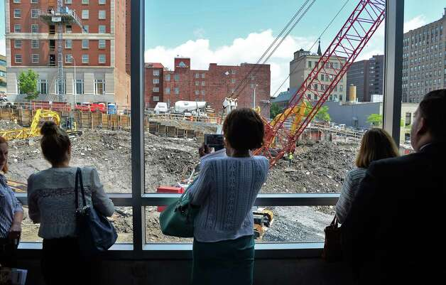 Community and business leaders get a look at the Albany Capital Center Site construction from the Times Union Center walkway Tuesday June 9, 2015 in Albany, NY.  (John Carl D'Annibale / Times Union) Photo: John Carl D'Annibale / 00032202A