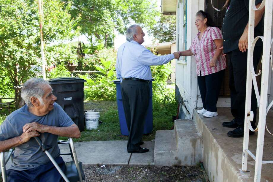 aTax Assessor-Collector, Albert Uresti, greets Angelita Lara Juarez at her home Tuesday June 9, 2015, as her and her husband, Frank, received property tax refund checks that was a result of the Tax OfficeÕs efforts to secure a residential homestead exemption reinstatement and the granting of a 65 and over exemption from the Bexar Appraisal District. The refund checks totaled $2349.64, and the Juarez family had overpaid their property taxes for the last fourteen years.  After falling behind on their mortgage payments to their lender the Juarez family will now be able save their home thanks to the refund checks. / Julysa Sosa For the San Antonio Express-News