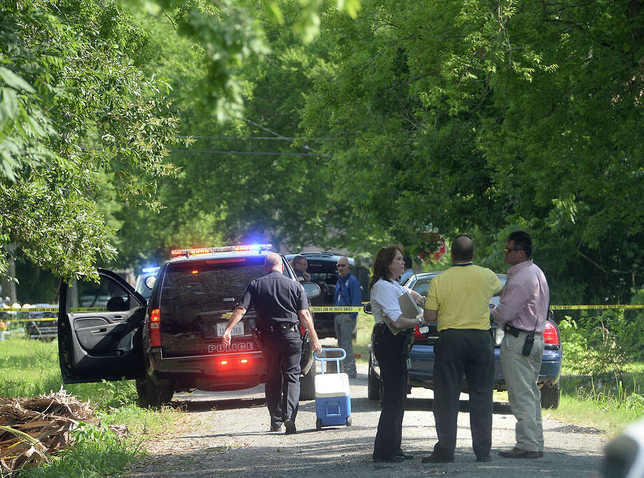 Police investigate after a body was reported lying in the middle of the road on Inca Street in Beaumont Tuesday. Police would only say that they suspect foul play in the young African-American man's death. Photo taken Tuesday, June 9, 2015 Kim Brent/The Enterprise Photo: Kim Brent / Beaumont Enterprise