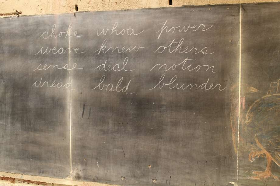 During a remodeling job at  Emerson High School in Oklahoma City, a work crew uncovered 100-year-old slate chalkboards.