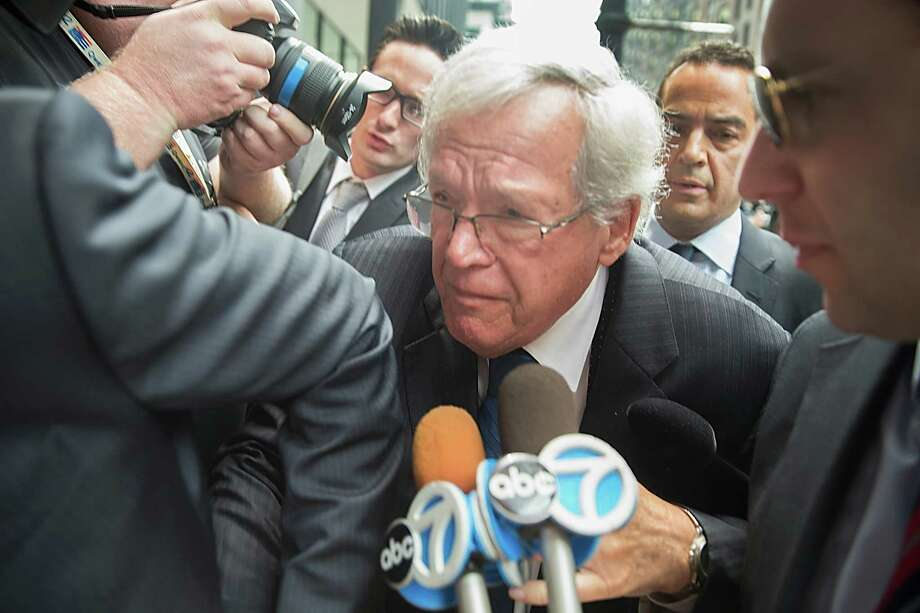 Former House Speaker Dennis Hastert fights his way through a mob of journalists as he arrives for the arraignment. Photo: Scott Olson /Getty Images / 2015 Getty Images