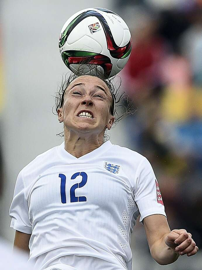 England defender Lucy Bronze jumps for the ball in a 1-0 loss to France. Photo: Franck Fife, AFP / Getty Images