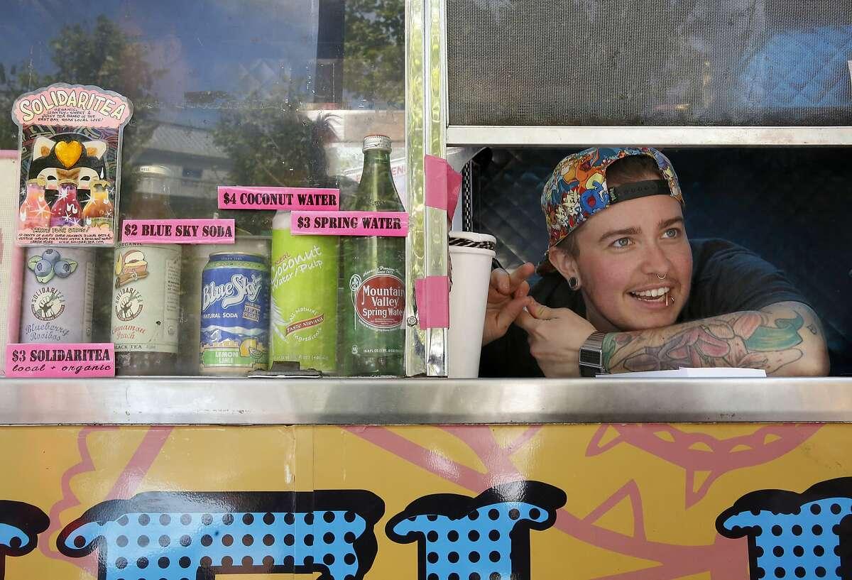 Window babe Brock Fraser waits on customers at Hella Vegan Eats in San Francisco, California, on Wednesday, June 3, 2015.