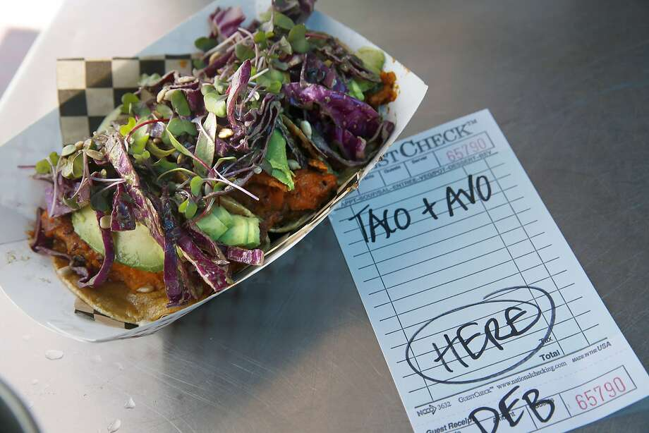 The Hella Vegan Eats food truck rotates its menu, ranging from tacos to a potsticker burrito to the doughnut burger. Photo: Liz Hafalia, The Chronicle