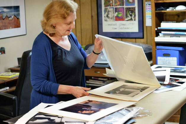 Eileen Schuyler, widow of the late photographer Joseph Schuyler looks through some of her husband's prints at her home Tuesday June 2, 2015 in Delmar, NY.  (John Carl D'Annibale / Times Union) Photo: John Carl D'Annibale / 00032095A