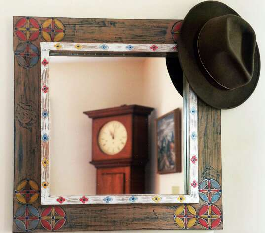 The trademark fedora of the late photographer Joseph Schuyler hangs at the entrance to his home Tuesday June 2, 2015 in Delmar, NY.  (John Carl D'Annibale / Times Union) Photo: John Carl D'Annibale / 00032095A
