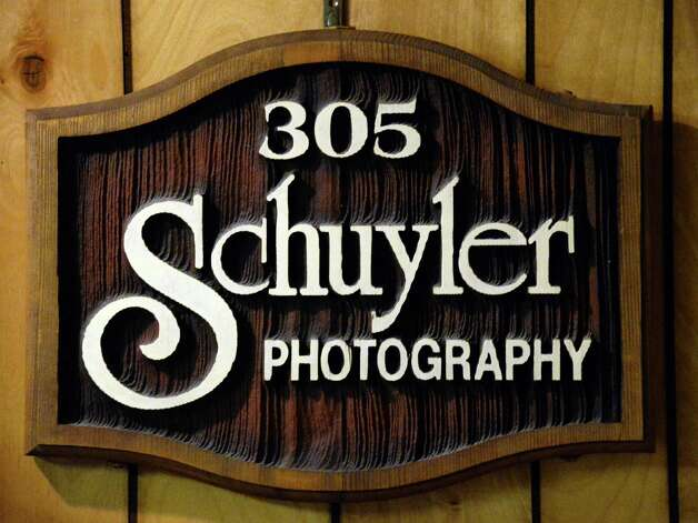 An old sign from a studio of the late photographer Joseph Schuyler at his home Tuesday June 2, 2015 in Delmar, NY.  (John Carl D'Annibale / Times Union) Photo: John Carl D'Annibale / 00032095A