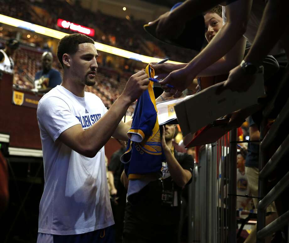 Golden State Warriors' Klay Thompson signs an autograph before playing Cleveland Cavaliers in  Game 3 of the 2015 NBA Finals at Quicken Loans Arena in Cleveland, Ohio, on Tuesday, June 9, 2015. Photo: Scott Strazzante, The Chronicle