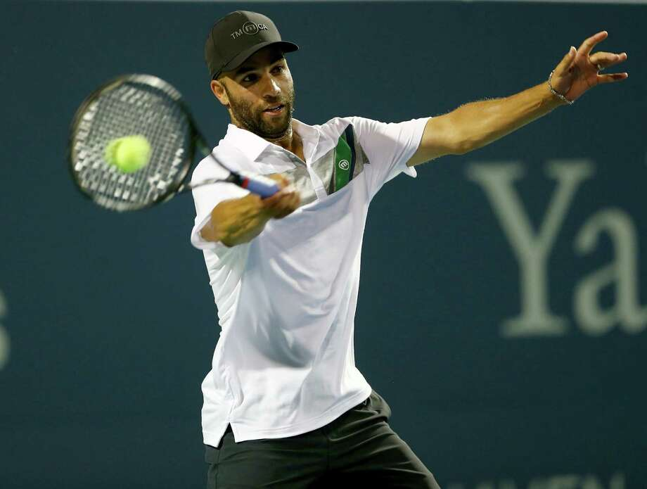 NEW HAVEN, CT - AUGUST 20:  James Blake returns a shot to Jim Courier during the Men's Legends match during the Connecticut Open at the Connecticut Tennis Center at Yale on August 20, 2014 in New Haven, Connecticut.Blake defeated Courier 7-5,6-3. Photo: Elsa, Getty Images / 2014 Getty Images