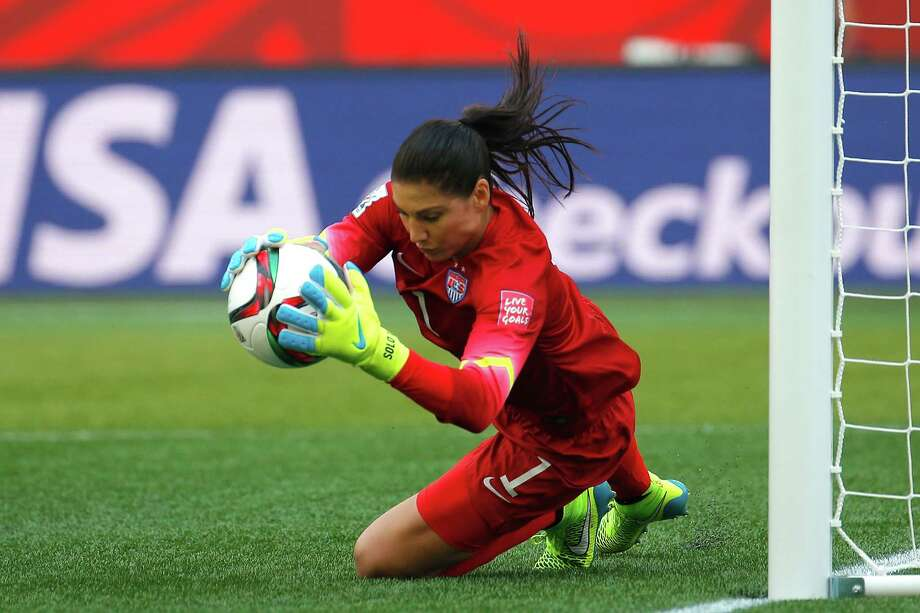 Hope Solo makes a save during the first half, when her strong work in goal kept the U.S. from falling behind it its opening game against Australia. Photo: Kevin C. Cox, Staff / 2015 Getty Images
