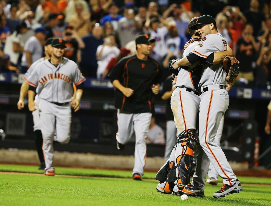 Giants starter Chris Heston (right) gets a hug from catcher Buster Posey after throwing a no-hitter against the Mets. Photo: Al Bello, Getty Images