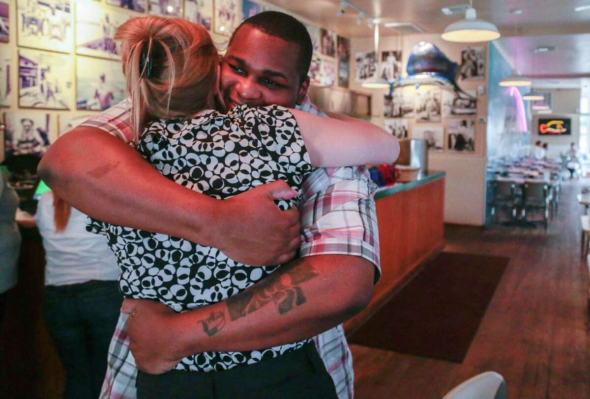 Alfred Brown hugs one of his attorneys, Megan Whisler, on Tuesday. Brown had been sentenced to death in the 2003 killing of Houston Police Officer Charles R. Clark, but is now free.