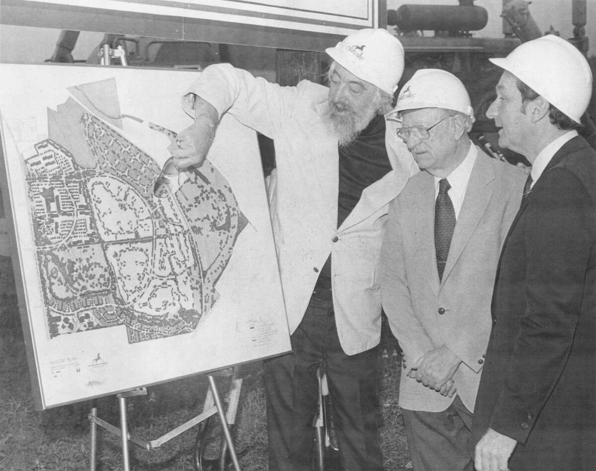 Robert L.B. Tobin (from left), Lloyd Denton and Israel Fogiel look at a map showing the layout of Oakwell Farms in a May 10, 1982, Express-News staff photo. by Jose Barrera.