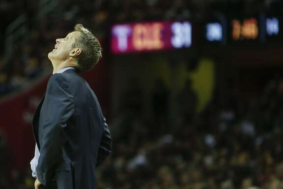 Golden State Warriors' Coach Steve Kerr looks up in the second period during Game 3 of The NBA Finals between the Golden State Warriors and Cleveland Cavaliers at The Quicken Loans Arena on Tuesday, June 9, 2015 in Cleveland, Ohio.