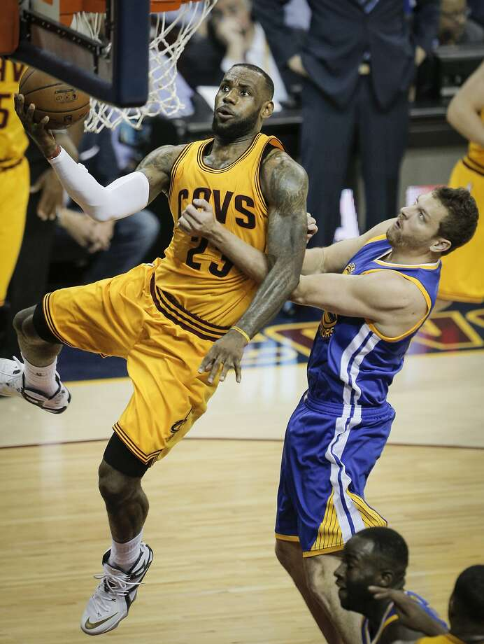 Cleveland Cavaliers' LeBron James drives past Golden State Warriors' David Lee in the second period during Game 3 of The NBA Finals between the Golden State Warriors and Cleveland Cavaliers at The Quicken Loans Arena on Tuesday, June 9, 2015 in Cleveland, Ohio. Photo: Carlos Avila Gonzalez, The Chronicle