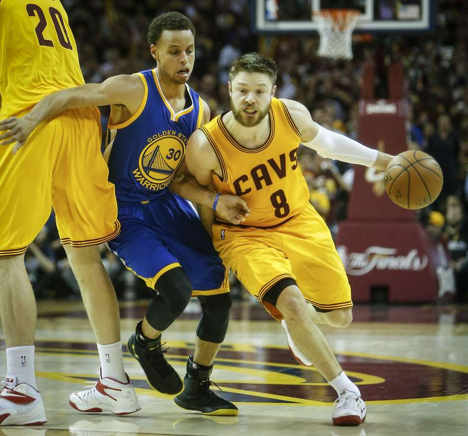 Cleveland Cavaliers' Matthew Dellavedova gets past Golden State Warriors' Stephen Curry in the third period during Game 3 of The NBA Finals between the Golden State Warriors and Cleveland Cavaliers at The Quicken Loans Arena on Tuesday, June 9, 2015 in Cleveland, Ohio. Photo: Scott Strazzante, The Chronicle