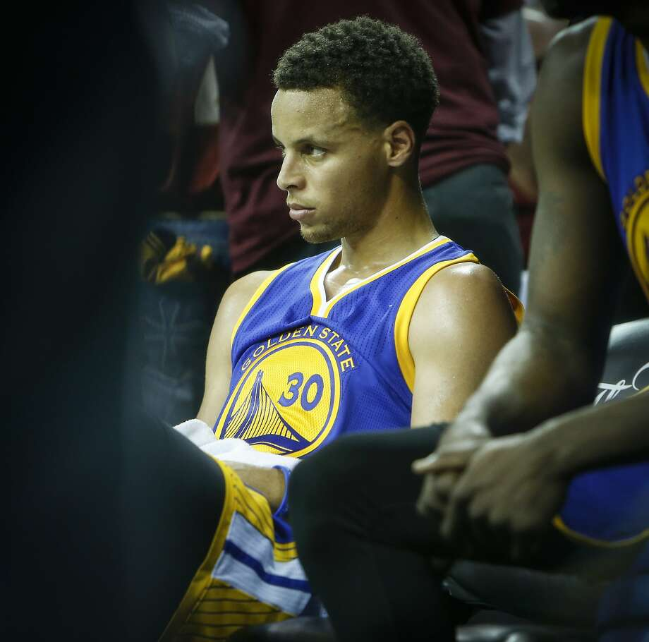 Golden State Warriors' Stephen Curry takes a break in the third period during Game 3 of The NBA Finals between the Golden State Warriors and Cleveland Cavaliers at The Quicken Loans Arena on Tuesday, June 9, 2015 in Cleveland, Ohio. Photo: Scott Strazzante, The Chronicle