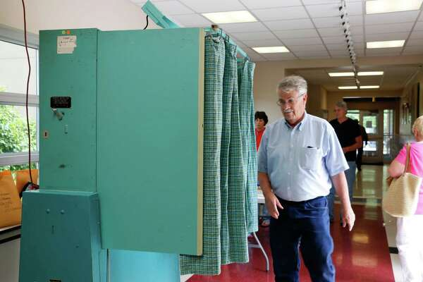 Tom Clingan, 64, of Cohoes walks into the voting booth inside Abram Lansing School on Tuesday, June 9, 2015, in Cohoes, N.Y. (Olivia Nadel/ Special to the Times Union)