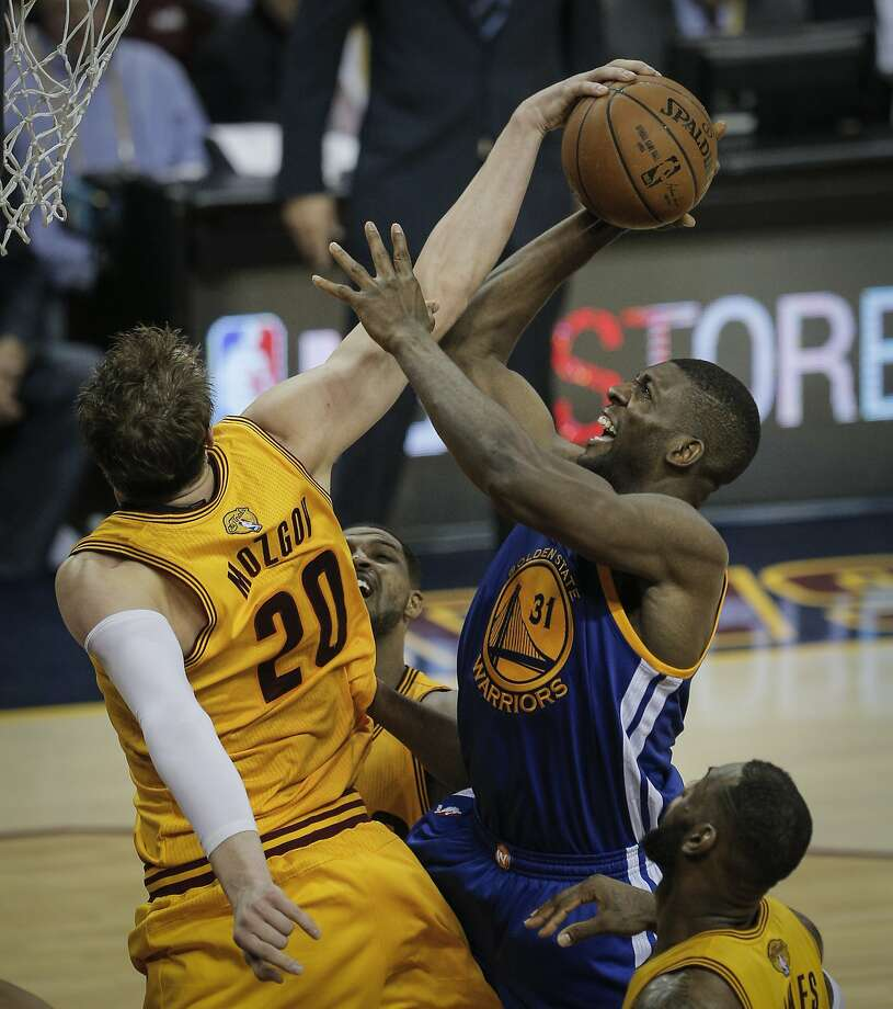 Cleveland Cavaliers' Timofey Mozgov gets a hand on a shot by Golden State Warriors' Festus Ezeli in the third period during Game 3 of The NBA Finals between the Golden State Warriors and Cleveland Cavaliers at The Quicken Loans Arena on Tuesday, June 9, 2015 in Cleveland, Ohio. Photo: Carlos Avila Gonzalez, The Chronicle