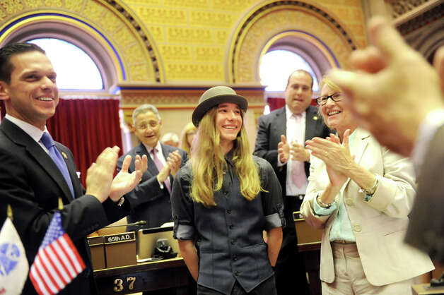 Sawyer Fredericks, winner of The Voice, center, receives recognition in the Assembly Chamber on Tuesday, June 9, 2015, at the Capitol in Albany, N.Y. Fredericks was the guest of Assemblyman Angelo Santabarbara, left. (Cindy Schultz / Times Union) Photo: Cindy Schultz, Albany Times Union / 00032213A