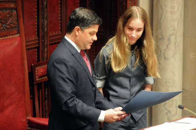 Sawyer Fredericks, winner of The Voice, right, joins Sen. George Amedore in the Senate Chamber on Tuesday, June 9, 2015, at the Capitol in Albany, N.Y. Fredericks removed his trademark bowler out of respect for the chamber. (Cindy Schultz / Times Union) Photo: Cindy Schultz, Albany Times Union / 00032213A