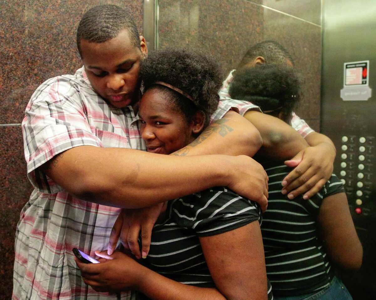 Alfred Brown hugs his fourteen year-old daughter Kiearra Simon in an elevator at Browns attorney's office Tuesday, June 9, 2015. Monday District Attorney Devon Anderson dropped the capital murder charges against Alfred Brown and he was released Monday. Alfred Brown had been sentenced to death in the 2003 killing of a Houston Police Department officer but is now a free from charges.