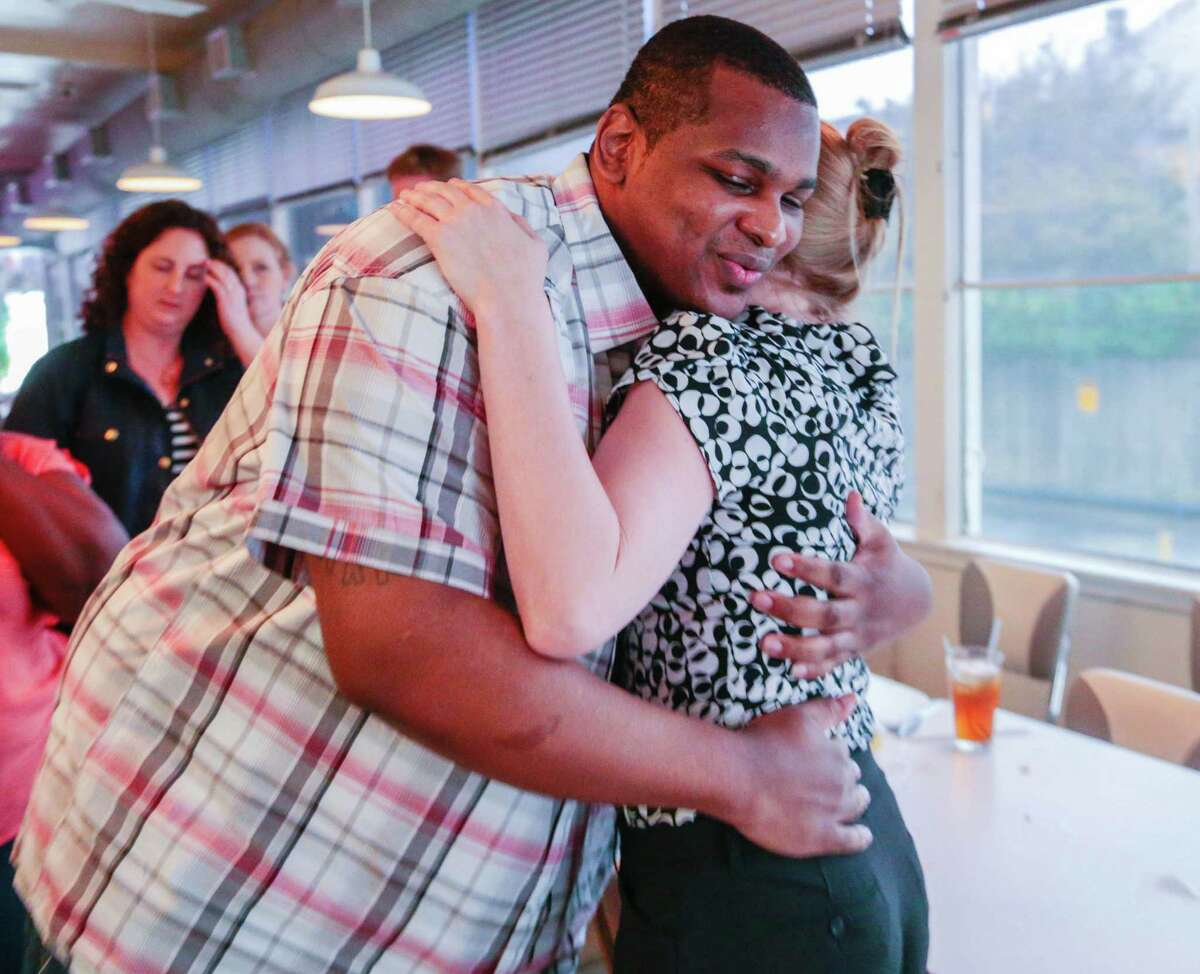 Alfred Brown hugs attorney Megan Whisler Tuesday, June 9, 2015. Whisler was responsible for finding the phone record in a police investigator's home garage. That led to the court's granting a new trial, for Brown. Monday District Attorney Devon Anderson dropped the capital murder charges against Alfred Brown and he was released Monday. Alfred Brown had been sentenced to death in the 2003 killing of a Houston Police Department officer but is now a free from charges.