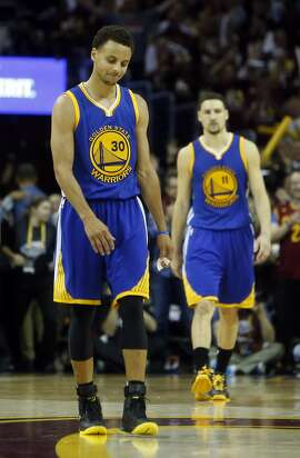 Golden State Warriors' Stephen Curry and Klay Thompson walk off court after Cleveland Cavaliers' 96-91 win during  Game 3 of the 2015 NBA Finals at Quicken Loans Arena in Cleveland, Ohio, on Tuesday, June 9, 2015.