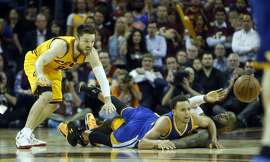 Golden State Warriors' Stephen Curry and Cleveland Cavaliers' LeBron James and Matt Dellavedova watch loose ball in 4th quarter of Cavs' 96-91 win during  Game 3 of the 2015 NBA Finals at Quicken Loans Arena in Cleveland, Ohio, on Tuesday, June 9, 2015.