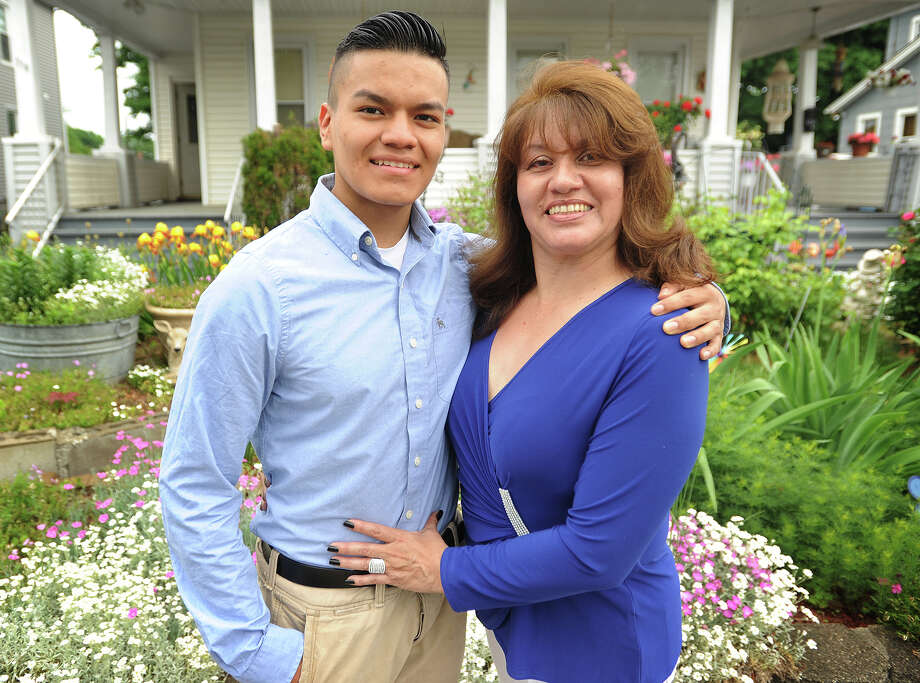 Ansonia High School 2015 Valedictorian Pablo Suarez, 17, and his mom Elina Proano outside their home in Ansonia, Conn. on Sunday, May 31, 2015. Suarez came to the U.S. six years ago speaking no English, and will attend Yale University in the fall. Photo: Brian A. Pounds / Staff Photographer / Connecticut Post
