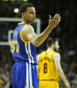 Golden State Warriors' Stephen Curry reacts to a call being overturned in final minute of Cleveland Cavaliers' 96-91 win during  Game 3 of the 2015 NBA Finals at Quicken Loans Arena in Cleveland, Ohio, on Tuesday, June 9, 2015.