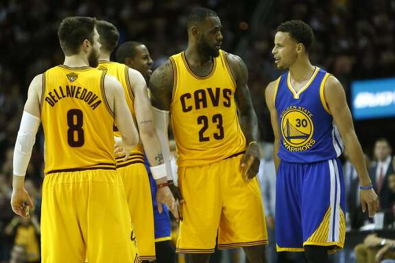 Golden State Warriors' Stephen Curry and Cleveland Cavaliers' LeBron James exchange words in final minute of 4th quarter of Cavs' 96-91 win during Game 3 of the 2015 NBA Finals at Quicken Loans Arena in Cleveland, Ohio, on Tuesday, June 9, 2015.