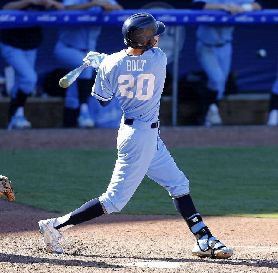 North Carolina's Skye Bolt hits before reaching reaches first on a dropped ball in the sixth inning against Clemson in the Atlantic Coast Conference baseball tournament in Durham, N.C., Friday, May 22, 2015. (Ethan Hyman/The News & Observer via AP) MANDATORY CREDIT Photo: Ethan Hyman, Associated Press