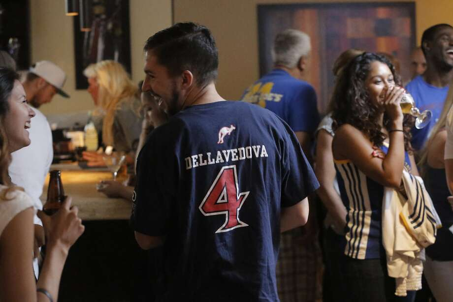 """Zach Silva, who was the manager of the 2010-2013 basketball team wears a Dellavedova jersey as they watch game 3 of the NBA finals at the 1515 Restaurant  in Walnut Creek, Calif., on Tues. June 9, 2015.  St. Mary's College alumni -- is rooting for the Warriors but also for Matthew """"Delly"""" Dellavedova '13, a guard with the Cleveland Cavaliers. Photo: Michael Macor, The Chronicle"""