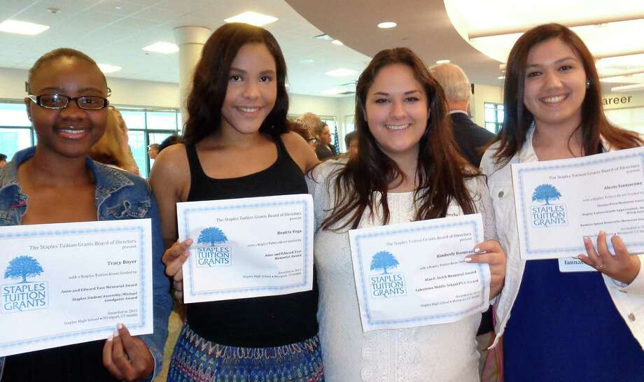 Four Staples High School seniors received Staples Tuition Grants for the first time at a ceremony Tuesday in the high school's library. They are, from left: Tracy Boyer, Beatriz Vega, Kimberly Ramirez and Alexis Iannacone. The young women had a chance to thank donors for their financial contributions, which will defray their college tuition costs. Photo: Meg Barone / Meg Barone / Westport News