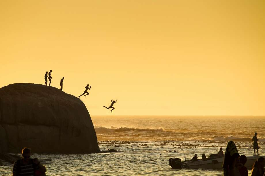 In this 2015 National Geographic Traveler Photo Contest entry, photographer Slawek Kozdras captures boys in Clifton Beach in Cape Town jumping into the Atlantic Ocean. Photo: Slawek Kozdras