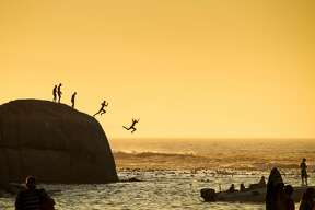 In this 2015 National Geographic Traveler Photo Contest entry, photographer Slawek Kozdras captures boys in Clifton Beach in Cape Town jumping into the Atlantic Ocean.
