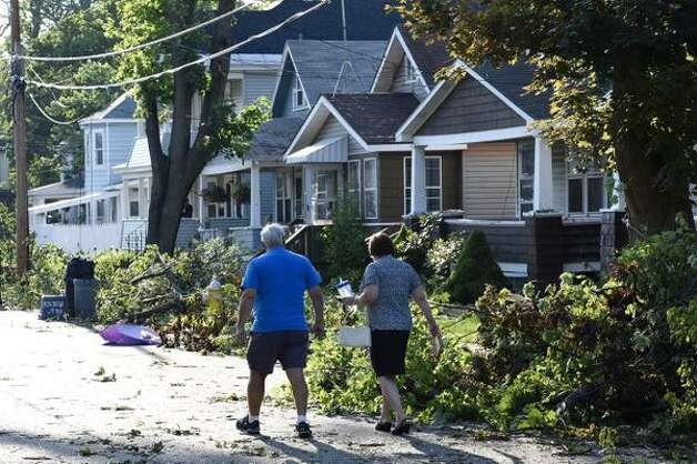 Residents of Sixth Avenue in Scotia survey the damage Wednesday morning, a day after a tornado hit the village. (Skip Dickstein / Times Union)