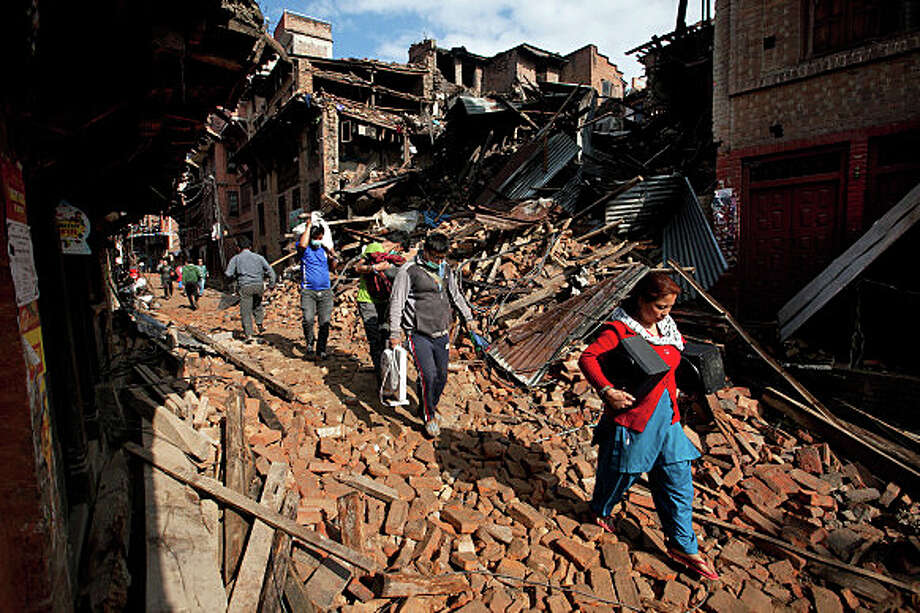 A basket-shooting event Friday at the Wakeman Boys and Girls Club will raise money to benefit relief efforts for Nepal, which suffered a devastating earthquake in April. Photo: Associated Press / Associated Press / Fairfield Citizen