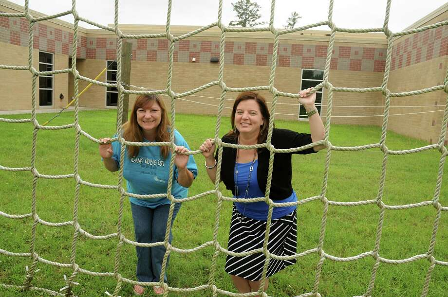 Deanne Moore and Bethanie Wheeler at the ropes course at the Community Learning Center for Humble ISD, 18901 Timber Forest Drive in Humble. Photograph by David Hopper. Photo: David Hopper, Freelance / freelance