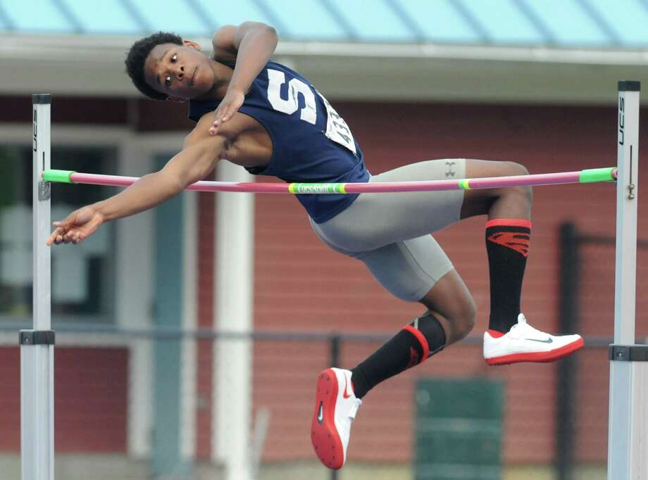 Staples' Anthony Bravo competes in the boys high jump at the CIAC Class LL Connecticut Outdoor Track & Field State Championship at Danbury High School in Danbury, Conn. Tuesday, June 3, 2014. Photo: Tyler Sizemore / Tyler Sizemore / The News-Times