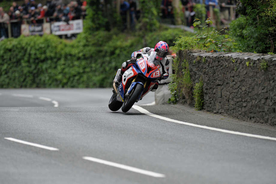 A 2015 Superstock Race competitor with both wheels off the ground at the Isle of Man TT. Photo: Simon Williams, IOMTT.com / COPYRIGHT SimonWilliamsPhotography COPYRIGHT