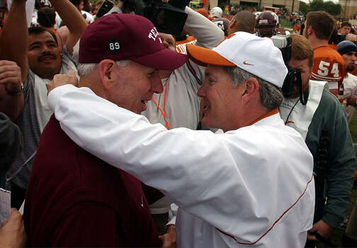 Texas A&M coach R.C. Slocum (left) and Texas coach Mack Brown meet on the field after the Longhorns' 50-20 win on Nov. 29, 2002, in Austin. Photo: Express-News File Photo / SAN ANTONIO EXPRESS NEWS