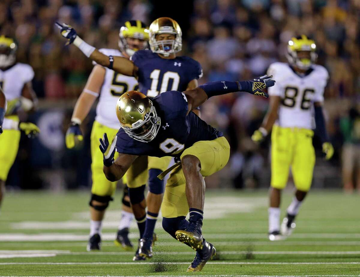 Notre Dame linebacker Jaylon Smith celebrates a tackle for a loss against Michigan during the second half on Sept. 6, 2014, in South Bend, Ind.